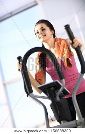 Young woman do exercises on the ellipsoid. The concept of a healthy lifestyle.