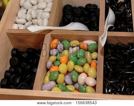 Colourful Assorted Sugared Almonds In Wooden Box