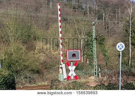 Open railway barrier at a railway crossing in Germany.