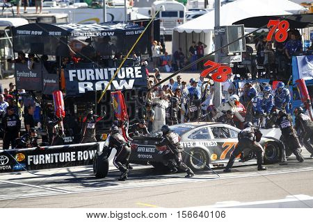 Avondale, AZ - Nov 13, 2016: Martin Truex Jr. (78) brings his race car in for service during the Can-Am 500(k) at the Phoenix International Raceway in Avondale, AZ.