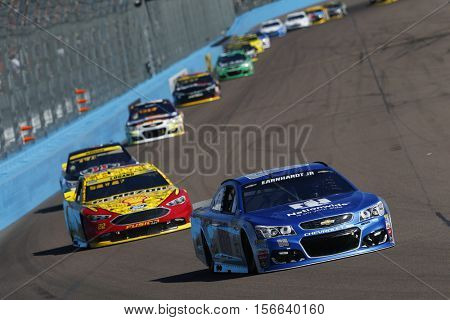 Avondale, AZ - Nov 13, 2016: Alex Bowman (88) battles for position during the Can-Am 500(k) at the Phoenix International Raceway in Avondale, AZ.