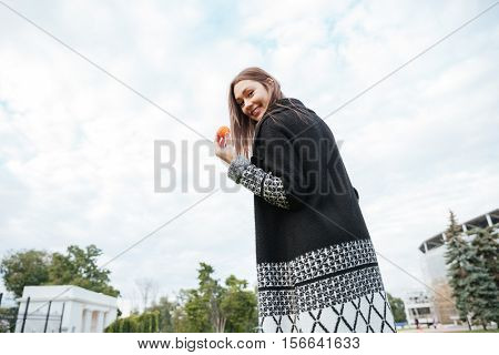Back view of happy yougn woman with small ball outdoors
