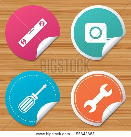 Round stickers or website banners. Screwdriver and wrench key tool icons. Bubble level and tape measure roulette sign symbols. Circle badges with bended corner. Vector