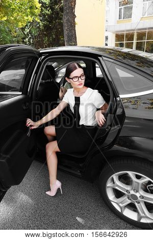 Beautiful woman out of car