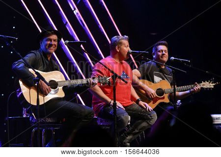 CHICAGO-NOV 9: (L-R) Joe Don Rooney, Gary LeVox and Jay DeMarcus of Rascal Flatts perform at CBS Radio's Stars & Stripes event at the Chicago Theatre on November 9, 2016 in Chicago, Illinois.
