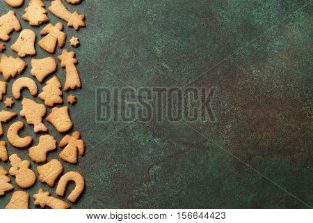 Christmas background with gingerbread cookies. Top view with copy space