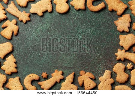Christmas background with gingerbread cookies frame. Top view with copy space