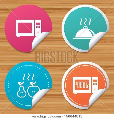 Round stickers or website banners. Microwave grill oven icons. Cooking apple and pear signs. Food platter serving symbol. Circle badges with bended corner. Vector