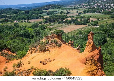 The reserve - pit on production ochre. Languedoc - Roussillon, Provence, France. Orange picturesque hills