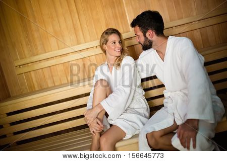 People couple enjoying and smiling sauna health benefits