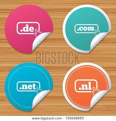 Round stickers or website banners. Top-level internet domain icons. De, Com, Net and Nl symbols with hand pointer. Unique national DNS names. Circle badges with bended corner. Vector