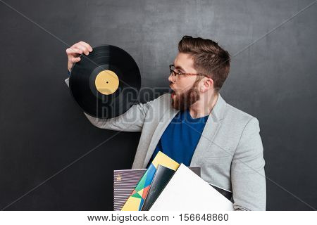 Man in jacket. Surprised man with vynil. isolated black background