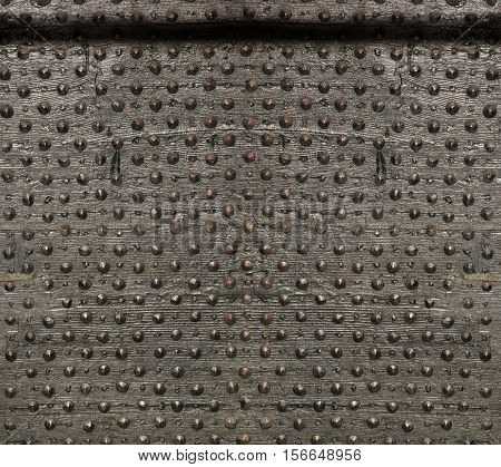 Texture of ancient wood with metal rivets