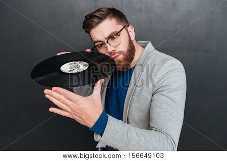 Man with vynil. vynil near the face. isolated black background