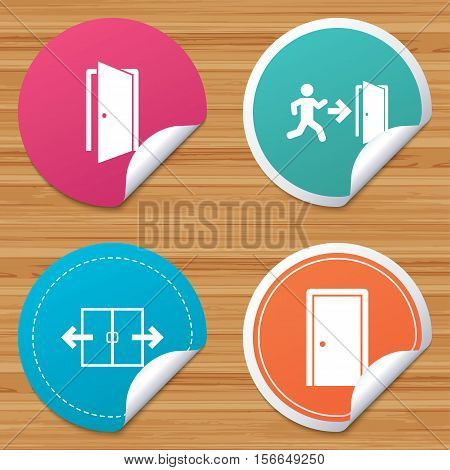 Round stickers or website banners. Automatic door icon. Emergency exit with human figure and arrow symbols. Fire exit signs. Circle badges with bended corner. Vector