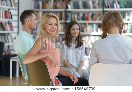 Smiling woman in library