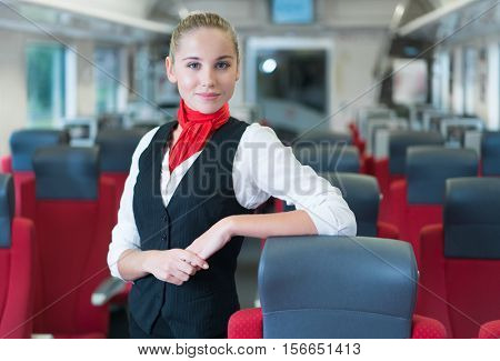 Young woman in uniform in the train