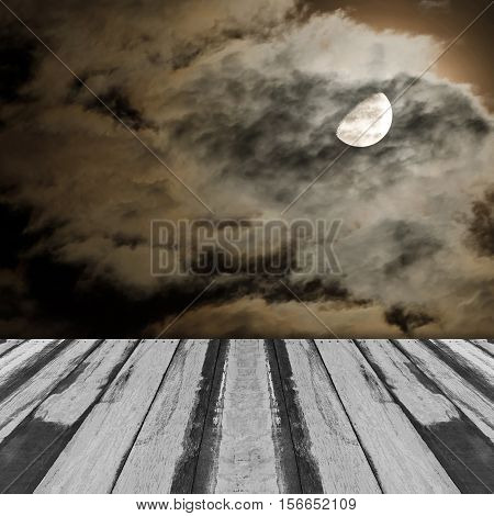 Abstract empty wooden interior room with moon and clouds in a cloudy night image on the wall