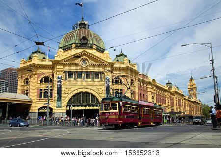 MELBOURNE, AUSTRALIA - OCTOBER 14, 2016: Flinders Street railway station, railway station on the corner of Flinders and Swanston Streets in Melbourne, Australia with a tramway in front of the station.