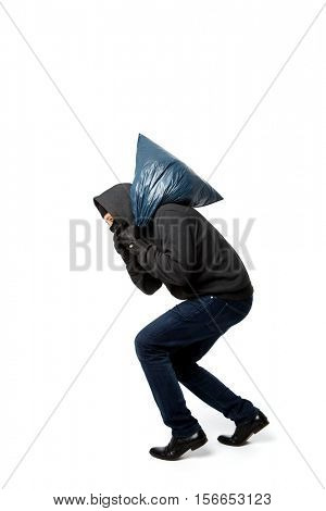 Robber slinking with large sack