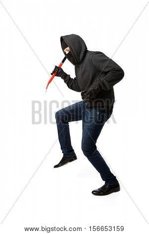 Burglar sneaks in black mask