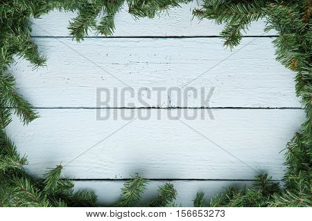 Wooden board with fir branches. Christmas and new year background