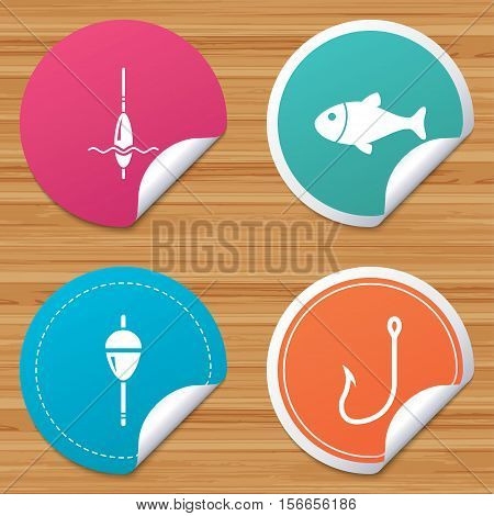 Round stickers or website banners. Fishing icons. Fish with fishermen hook sign. Float bobber symbol. Circle badges with bended corner. Vector