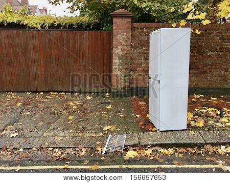 Discarded Fridge Freezer in an autumnal residential street poster