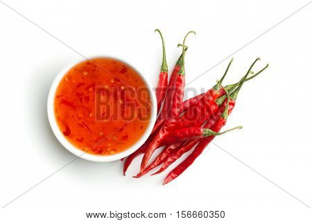 Red chili peppers and chili sauce isolated on white background.