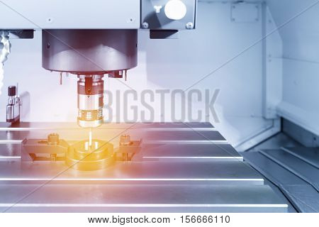 The probe for measurement the sample part on the CNC machine with lighting effect