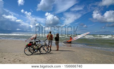 Latvia, Liepaja - July 30, 2015: Spectators of the competition on the seashore in Latvia