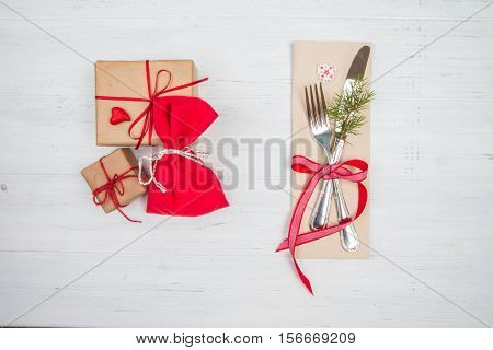 Christmas Cutlery And Holiday Gifts On White Table