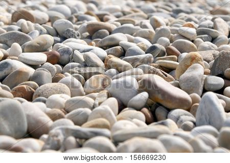 Close up of rounded and polished beach rocks