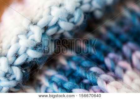 handicraft, knitwear and needlework concept - close up of knitted item