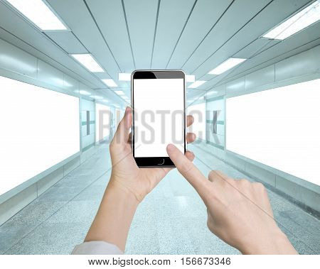 Woman Hand Holding Smart Phone With Forefinger Touching White Screen