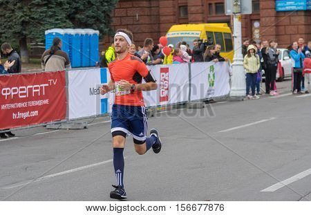DNEPR UKRAINE - SEPTEMBER 25 2016:Young bearded man hurrying to finish line during