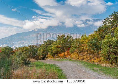 Autumnal landscape with earth road in mountain Crimean peninsula