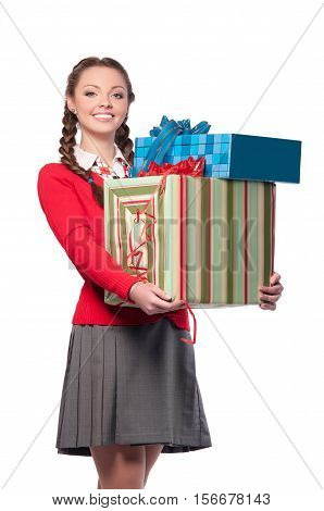 beautiful young woman holding boxes with gifts isolated background