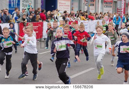 DNEPR UKRAINE - SEPTEMBER 25 2016:Young participants hurrying to finish line during kids section of