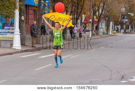 DNEPR, UKRAINE - SEPTEMBER 25, 2016:Participant as a pacemaker with red balloon that shows desired time on a