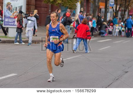 DNEPR UKRAINE - SEPTEMBER 25, 2016:Senior participant hurrying to finish line during