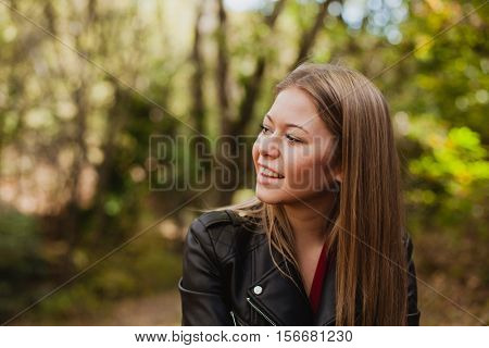 Beautiful woman in a beautiful forest in autumn