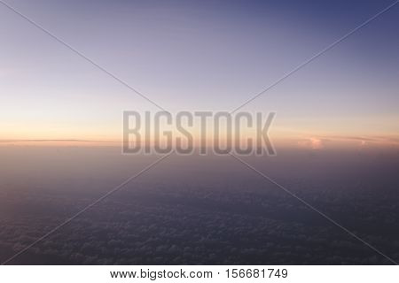 colorful blue and gold gradient sky just before sunrise view form airplane with copyspace