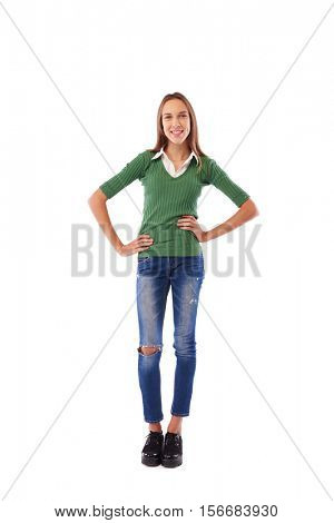 Full-length portrait of a beautiful smiling girl with her arms on hips isolated on the white background