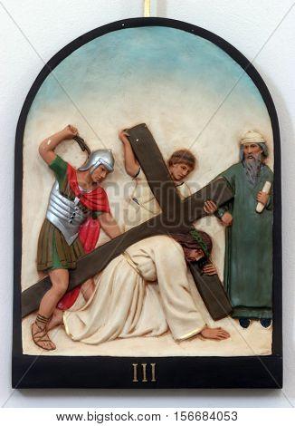HRVATSKA DUBICA, CROATIA - NOVEMBER 18: 3rd Stations of the Cross, Jesus falls the first time, Parish Church of Holy Trinity in Hrvatska Dubica, Croatia on November 18, 2010.