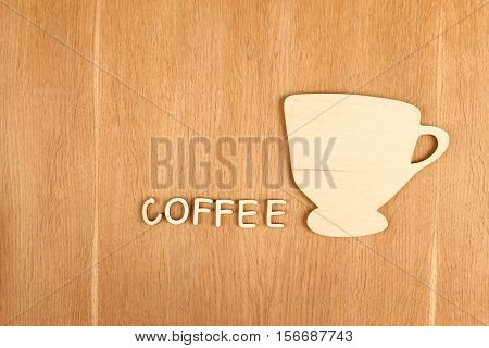 Close-up silhouette of a wooden cup. Background