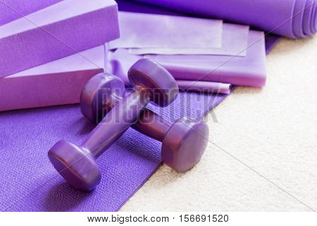 Fitness yoga pilates equipment props on a carpet