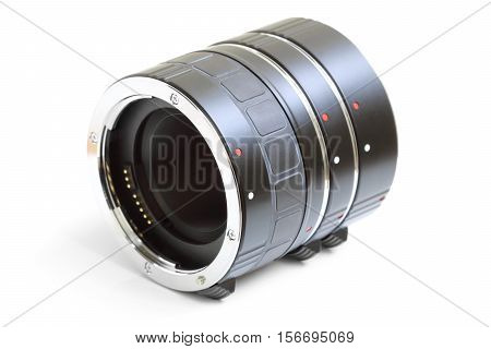 Set of extension tube used for macro photography on white background