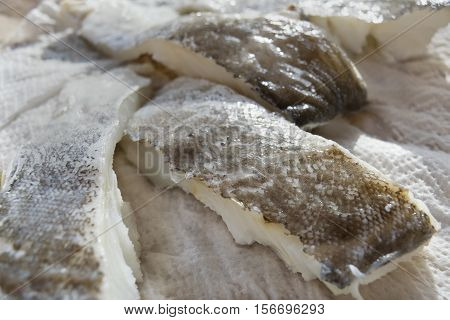 fillets of raw dried salted cod of norway