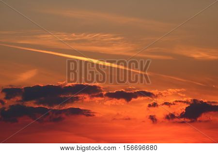 Sunset with clouds and orange atmospheric effect